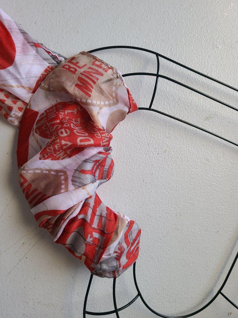 Wrap the scarf around the DIY Valentine's Wreath