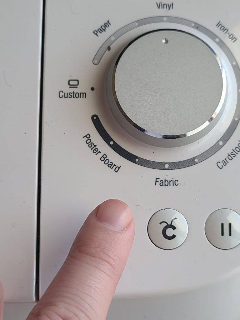 Press arrow button to load vinyl into the Cricut.