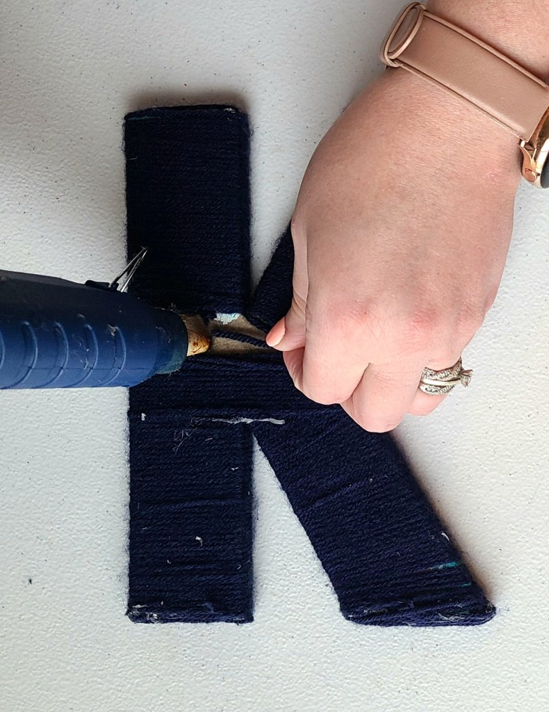 Nautical initial K fully wrapped in navy yarn.