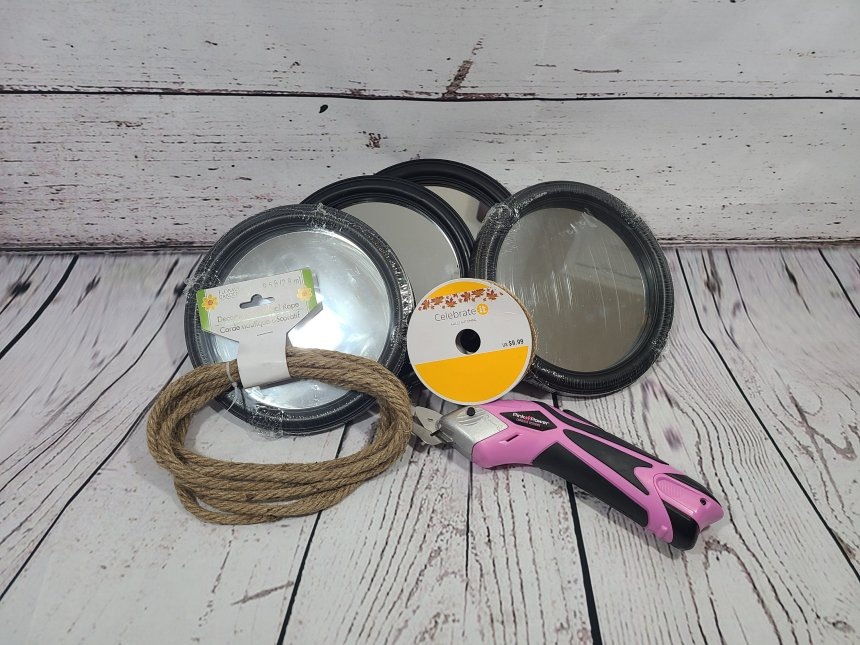 Supplies needed for nautical mirrors: nautical rope, round black rimmed mirrors, jute ribbon.