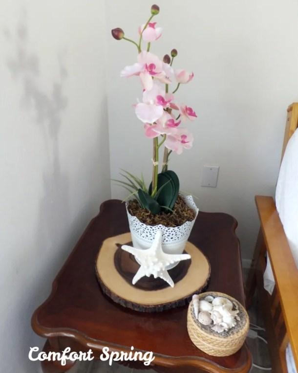 Faux orchid floral arrangement