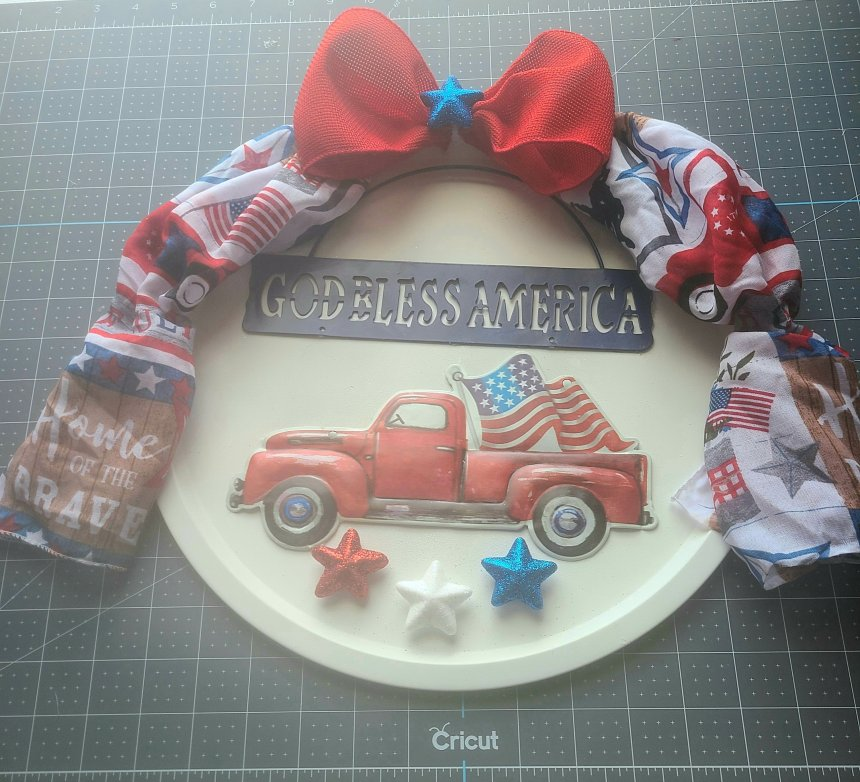 Red, white, and blue glitter stars added to the bottom of the patriotic pizza pan wreath.