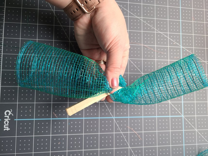 Two spiral rolls of deco mesh held together in the center by a clothes pin. Two are combined to make one of the proper size.