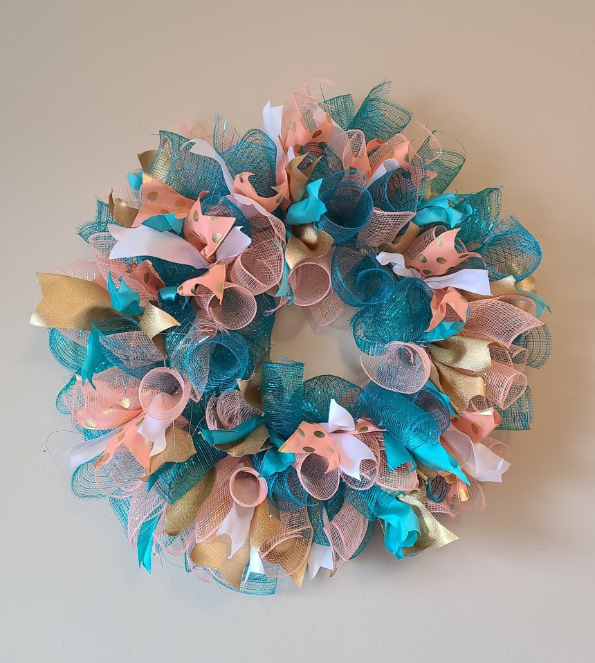 Spiral deco mesh wreath tutorial pic with all of the mesh spirals and ribbon added covering the entire form.