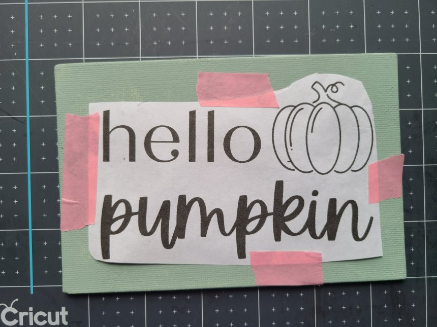 """""""Hello pumpkin"""" design taped on the DIY sign without a Cricut using washi tape."""