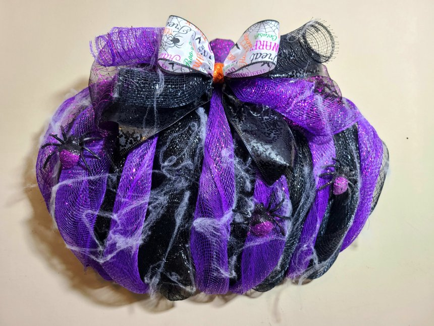 Complete Halloween wreath with spiders and lots of spiderwebbing.