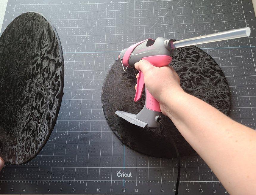 Adding hot glue along the edge of the bottom splatter screen.