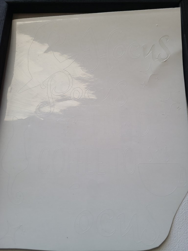The vinyl stencil on canvas is cut from clear vinyl.