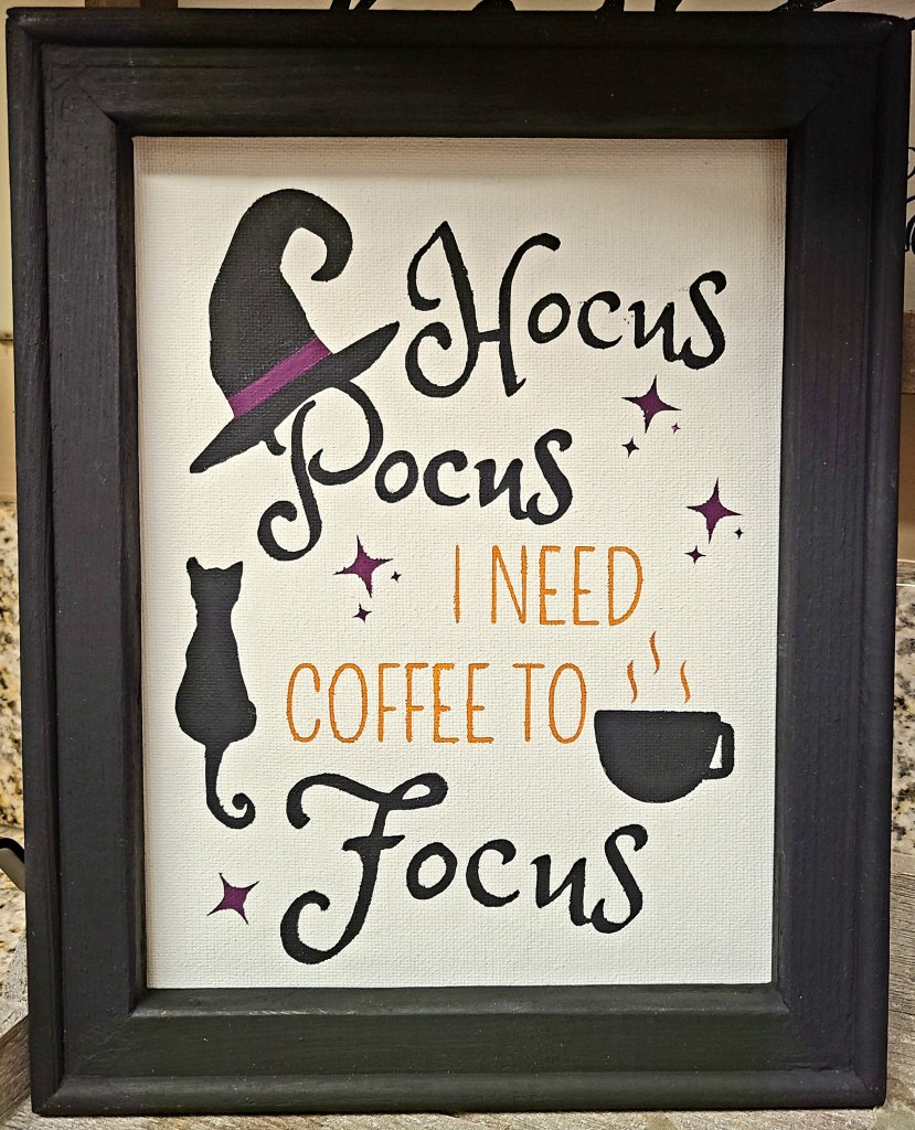 Hocus Pocus sign painted on a reverse canvas.
