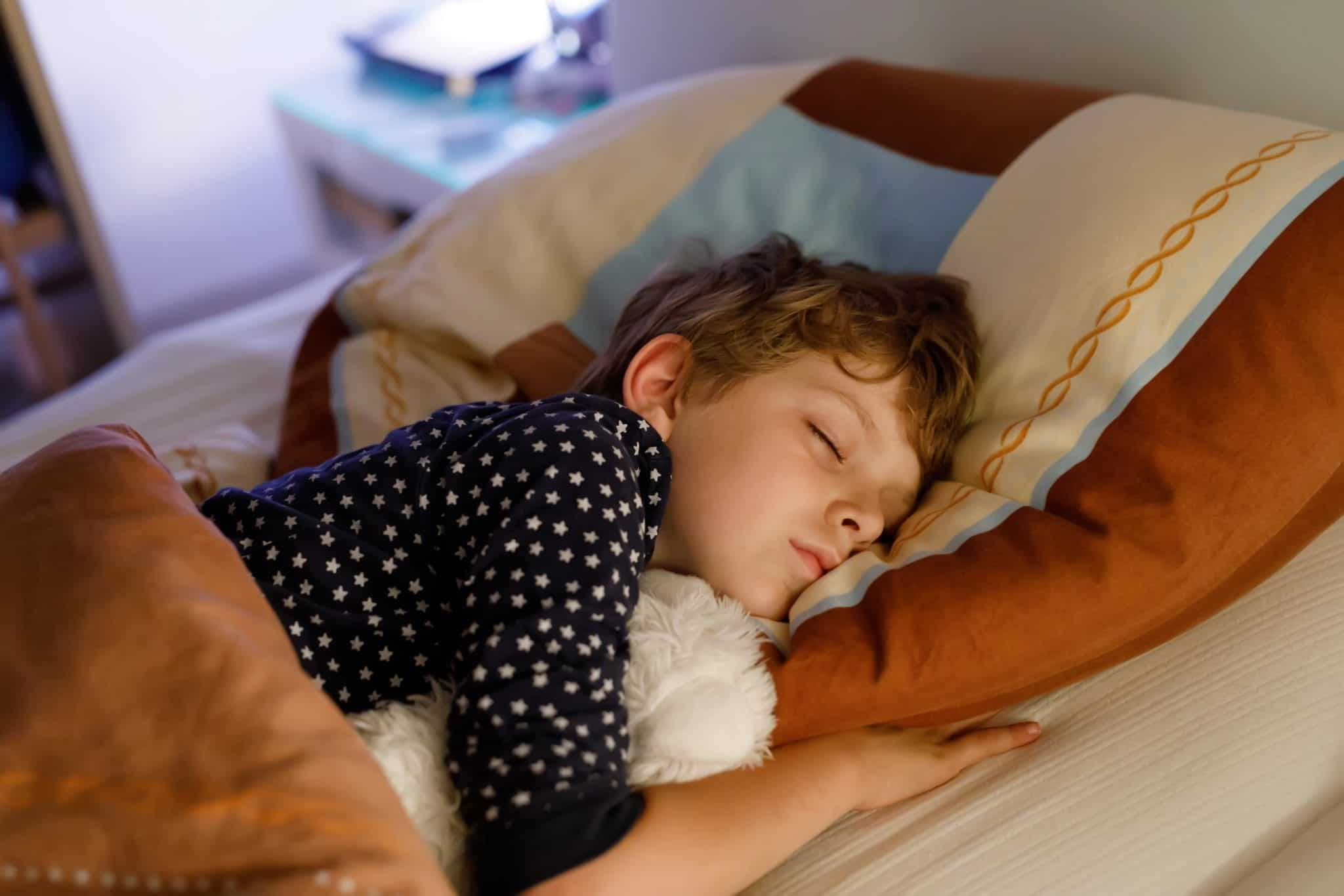 young boy sleeping kid sleep apnea