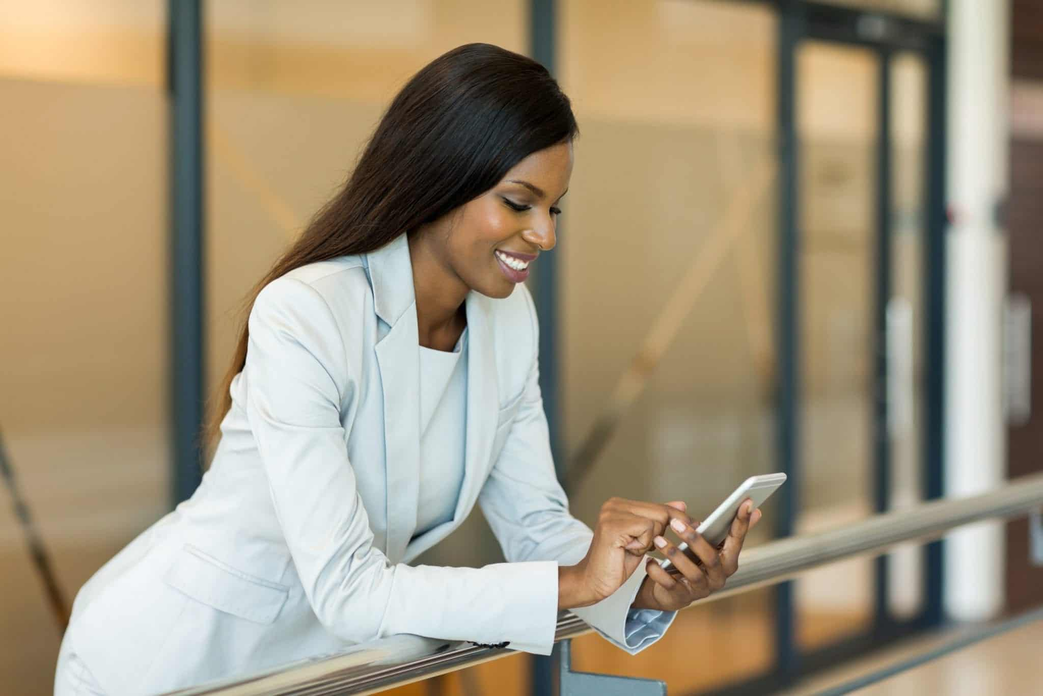 professional young career woman using smart phone