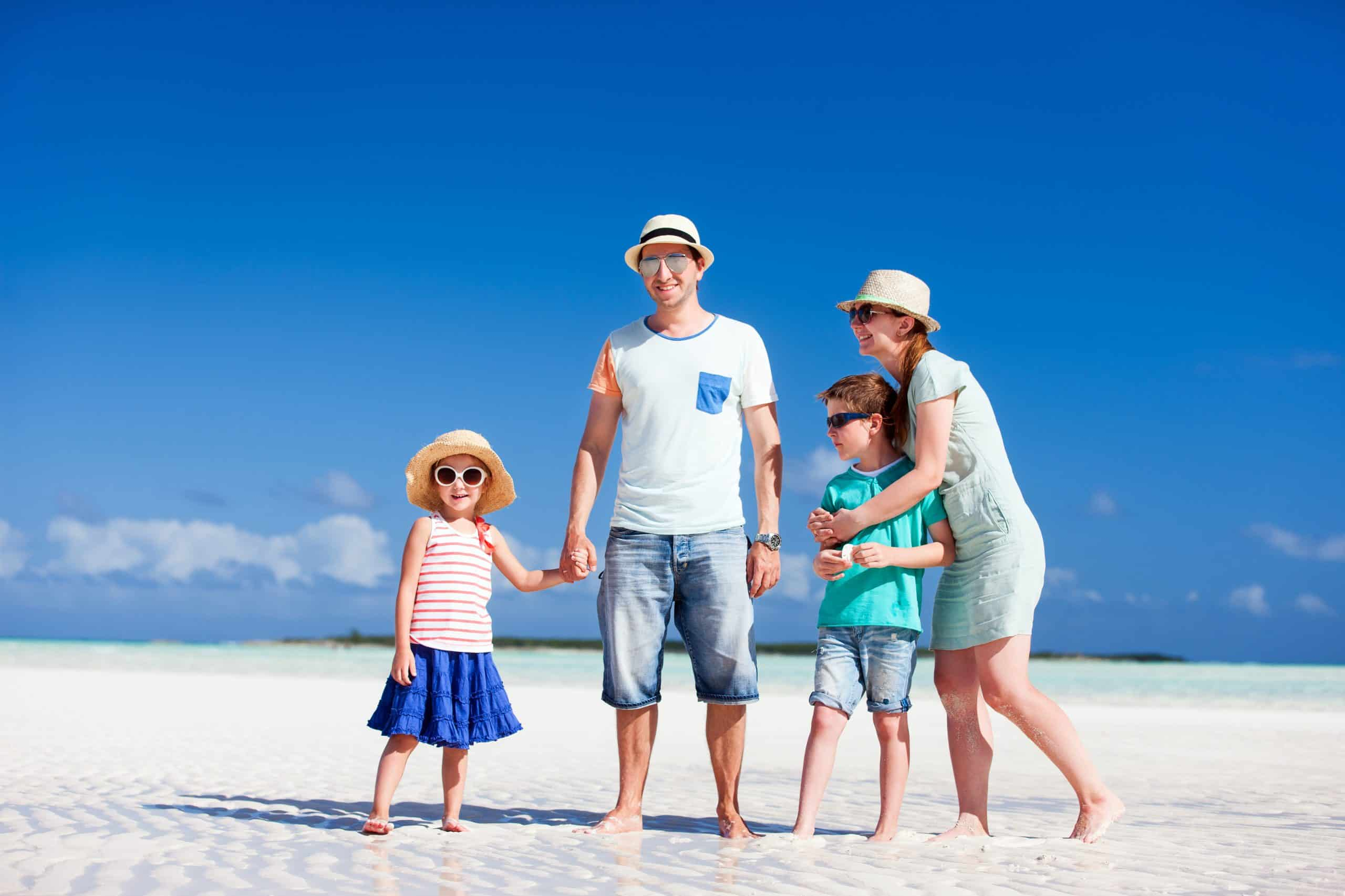 traveling with kids Happy beautiful family on a beach during summer vacation