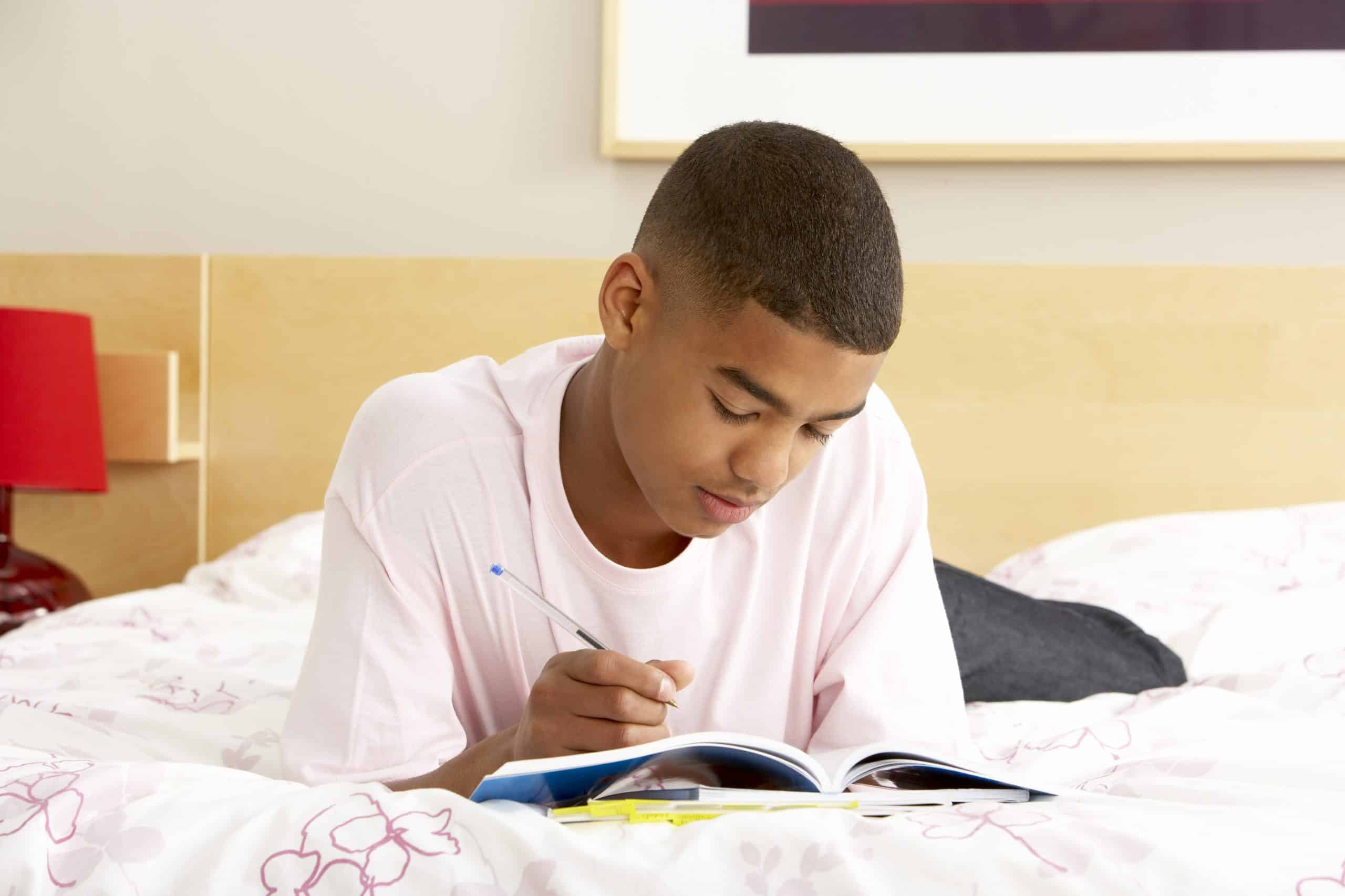 help boys express emotions boy writing in diary