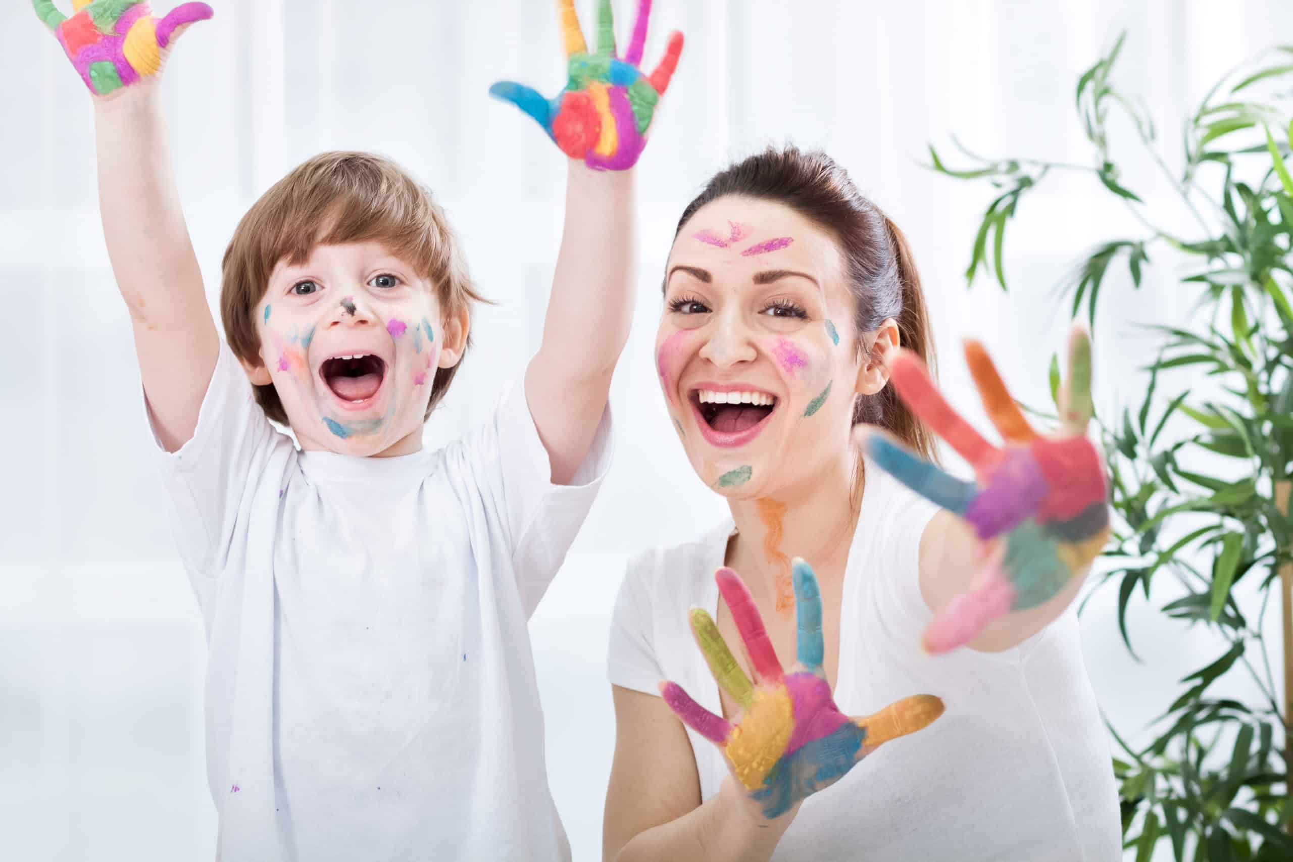 child learn finger painting