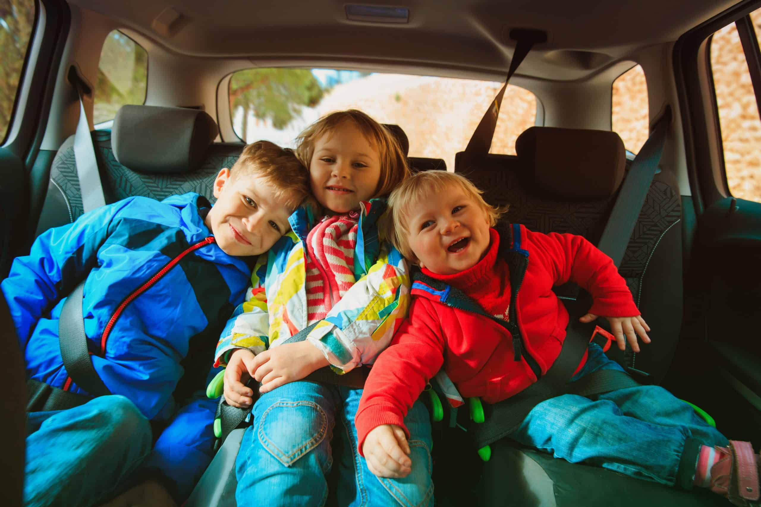 happy kids enjoy travel by car, family adventure, vacation concept