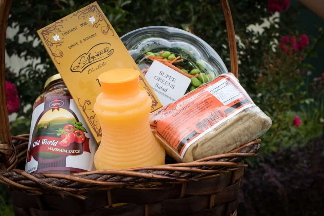 gift basket with juice and snacks