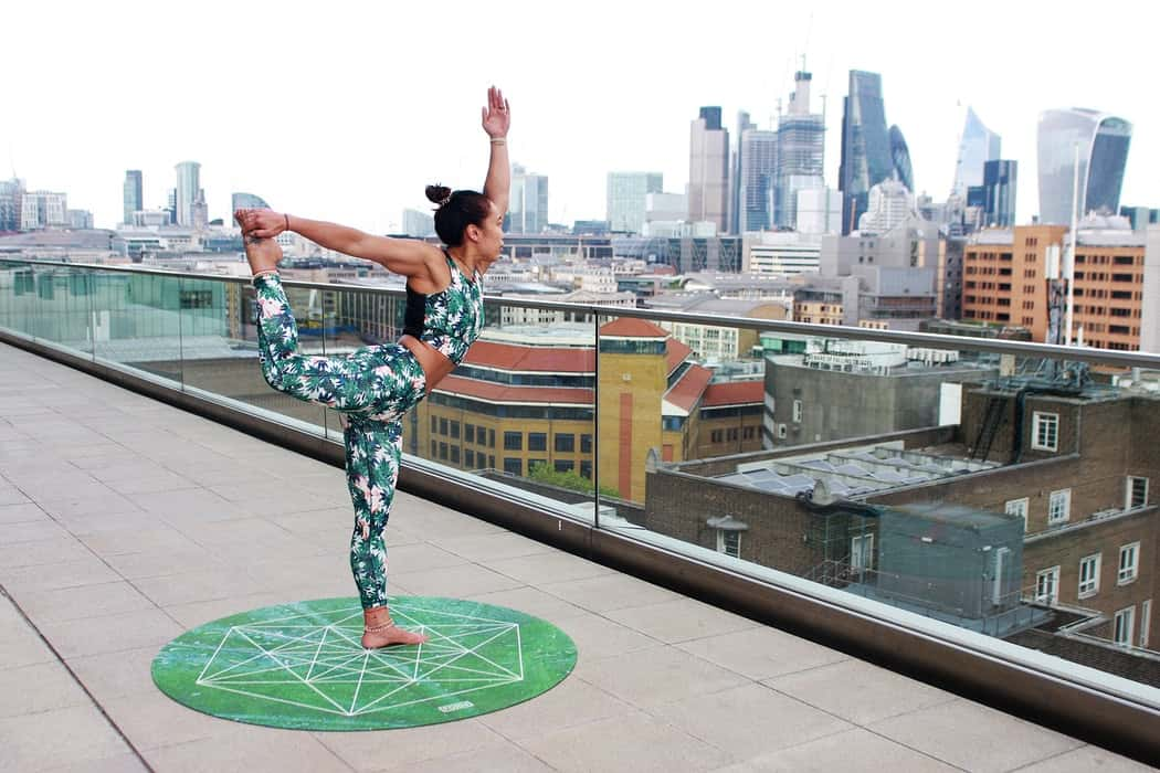 lady doing yoga on balcony