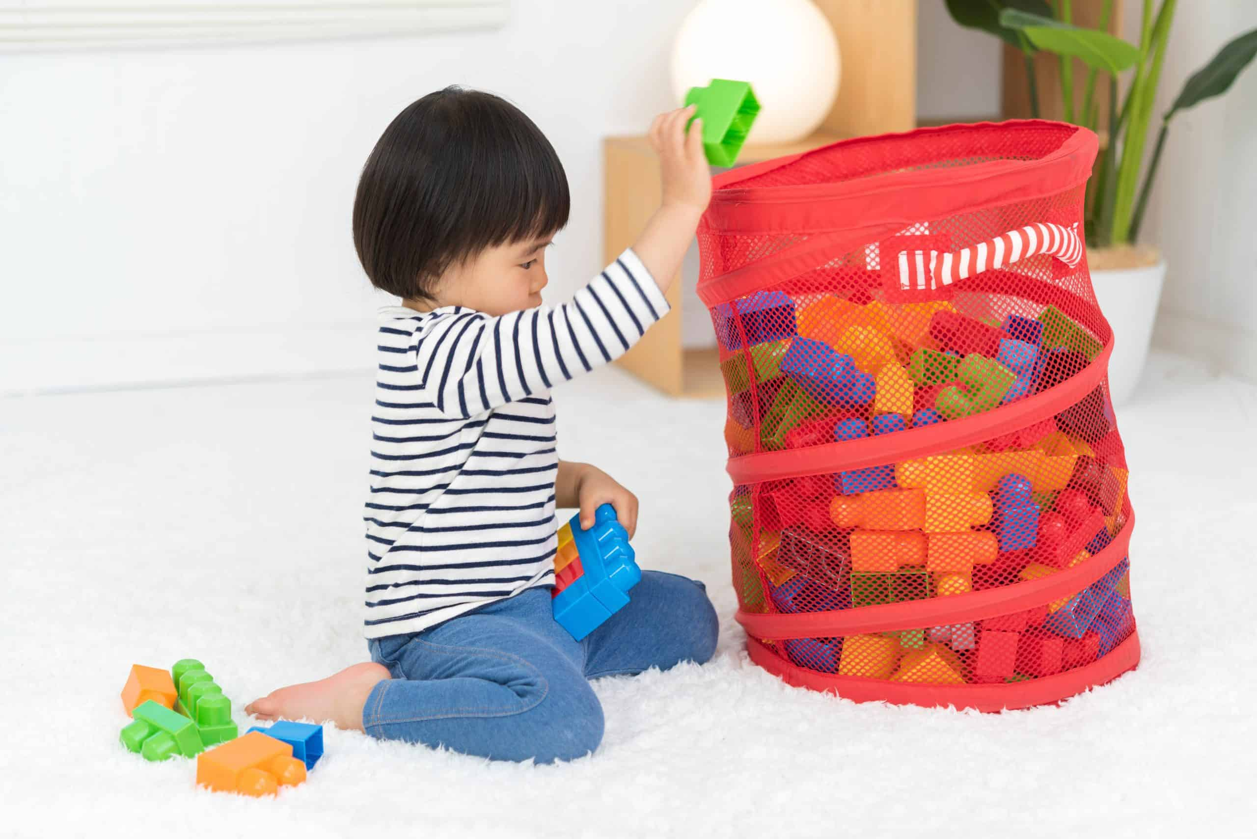 child cleaning up the room, declutter