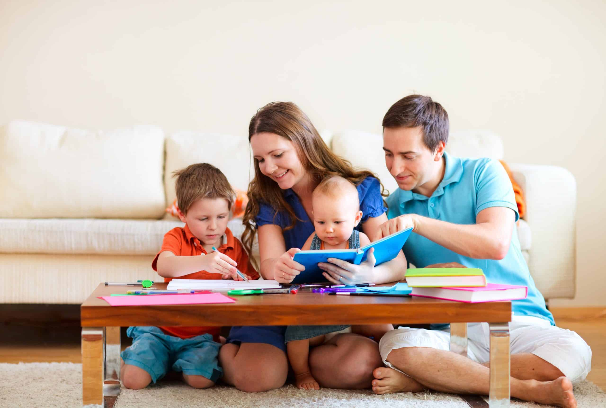 family reading and writing together