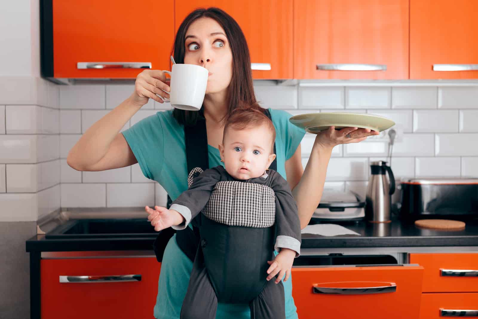 Busy Multitasking Mom with Baby, Coffee Mug and Dishes