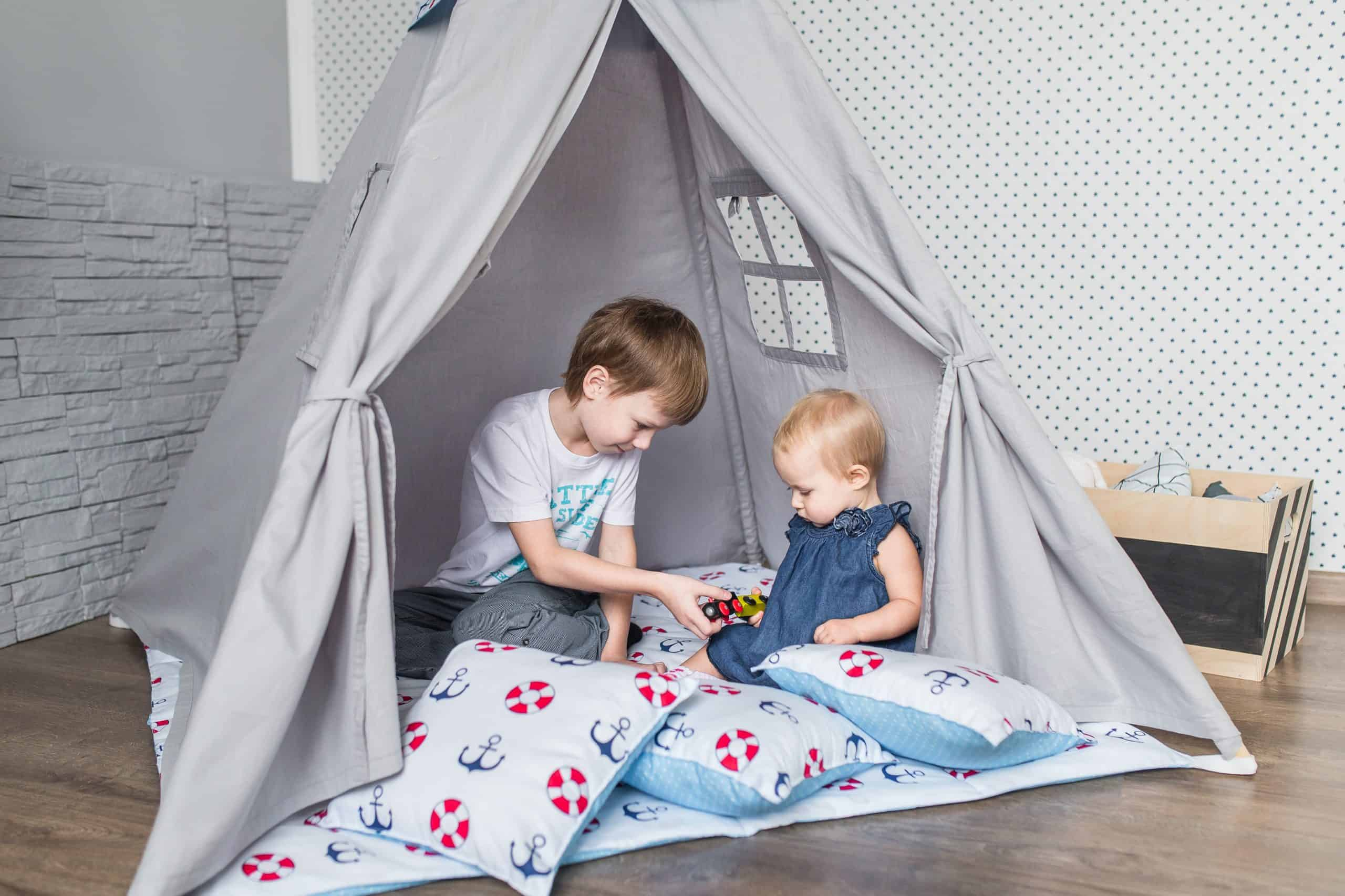 Child playing with a teepee tent