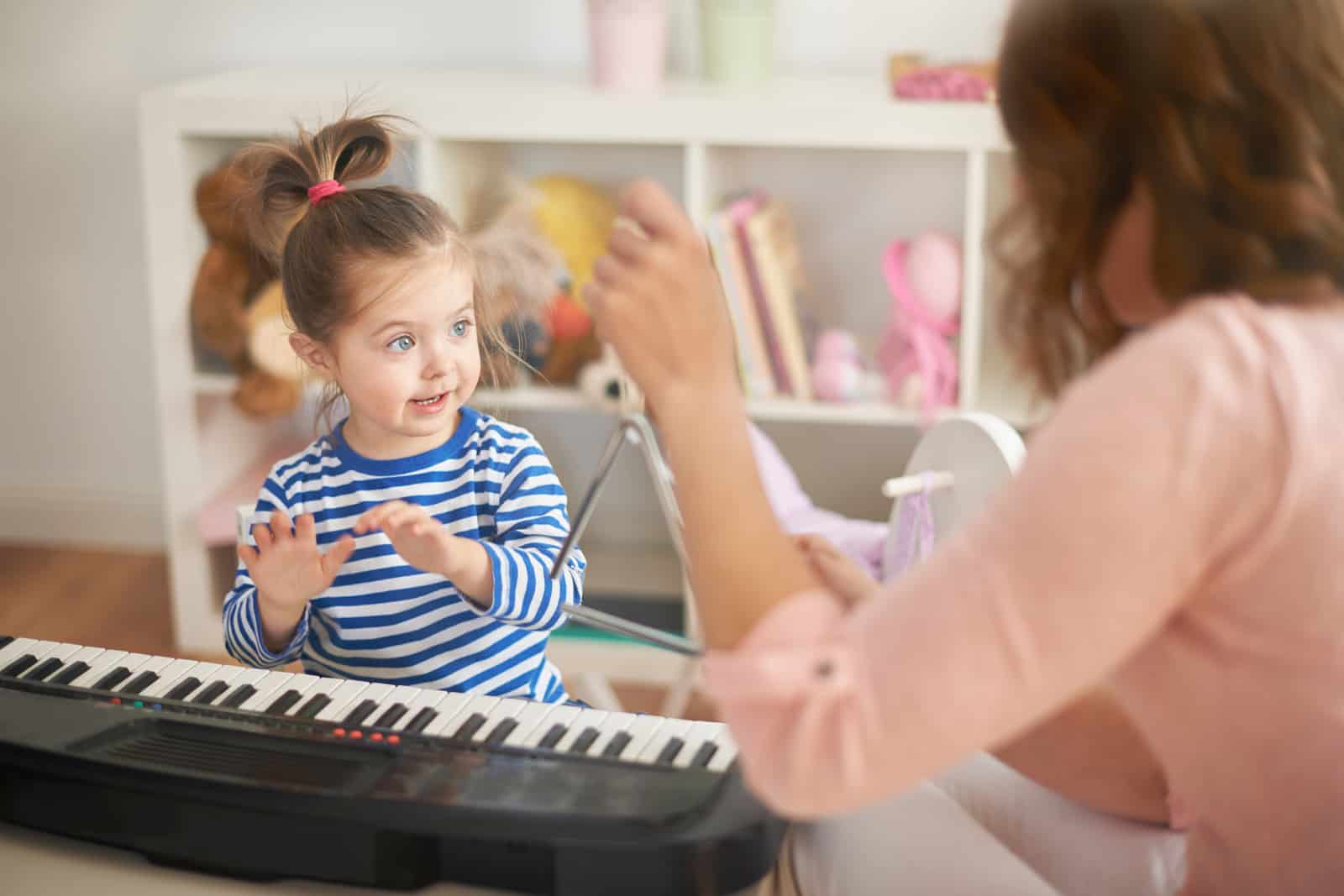 mom and daughter playing piano, kids activities at home
