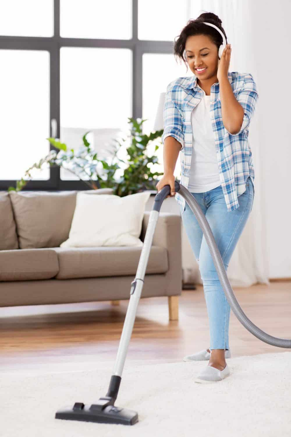 full-time mom vacuuming with headphones