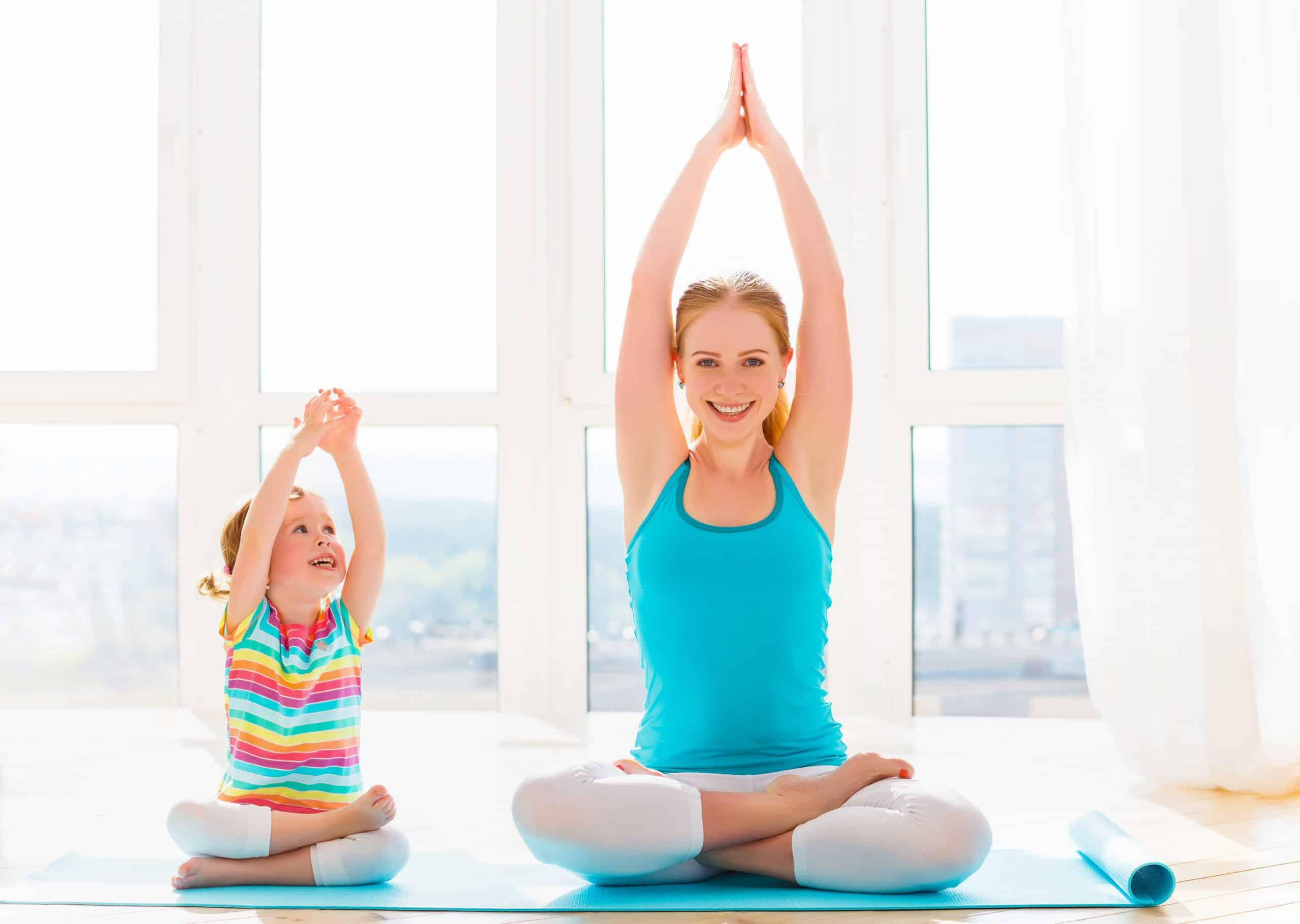 mom and child exercising, doing yoga