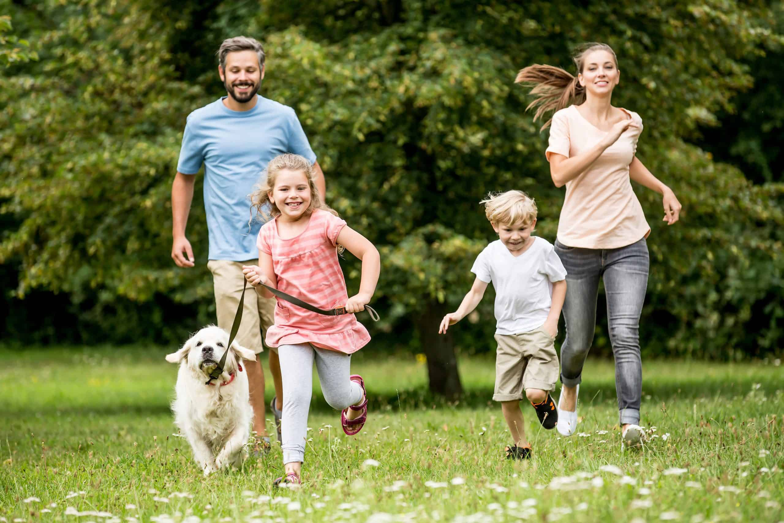 Happy children and parents with dog
