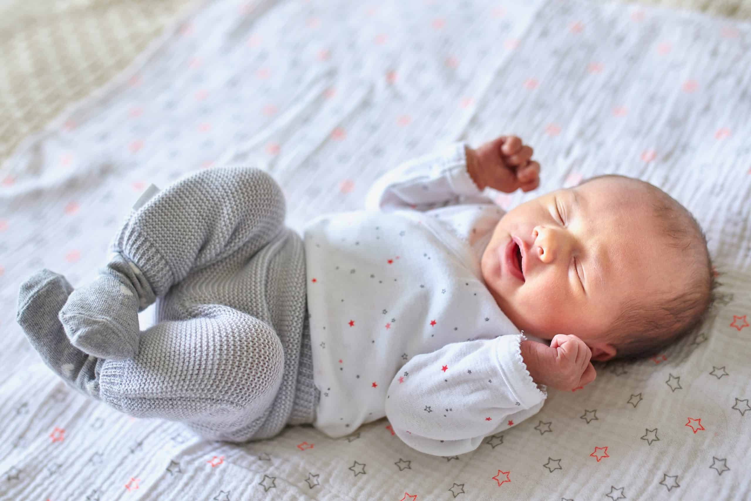 Newborn baby girl at home, baby nap time