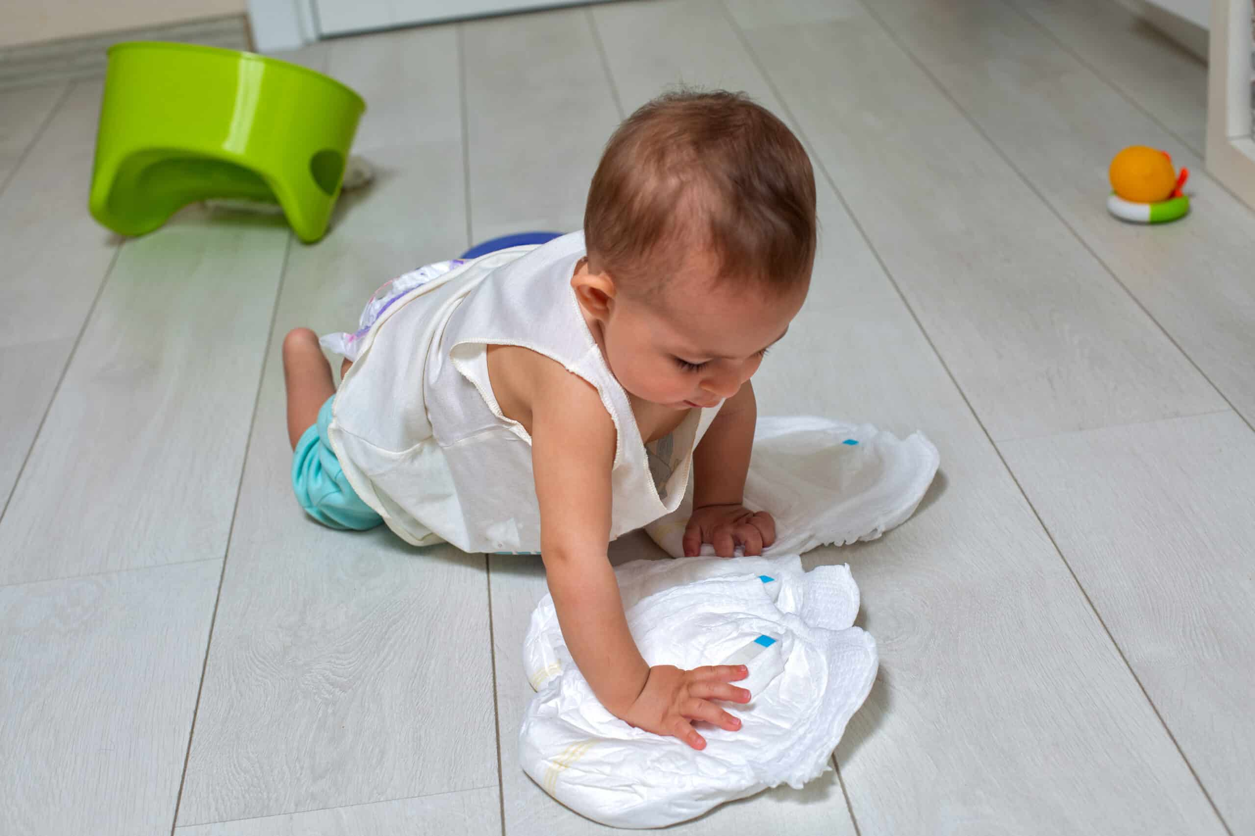 Potty Training Concept. A Cute Little Baby In A Room On The Brig