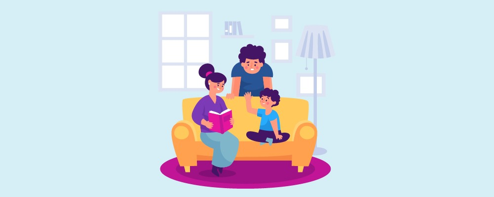 Family on a couch reading to child