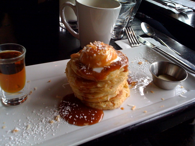 Adam's toasted coconut pancakes with caramel sauce and whipped cream