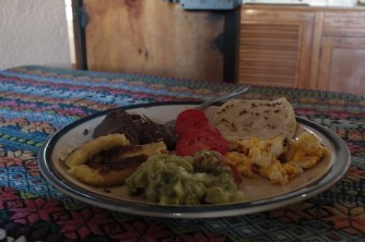 The first meal I cooked! Basically desayuno tipico - eggs, refried black beans, fried plantains, tomato, guacamole, and tortilla. Delicious!