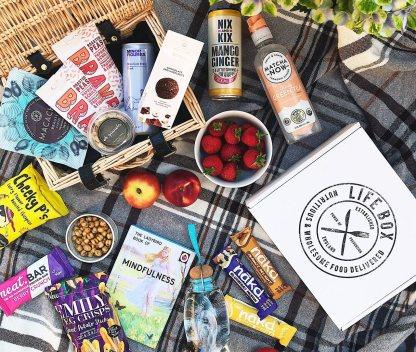Lifebox Vegan snacks on a picnic blanket