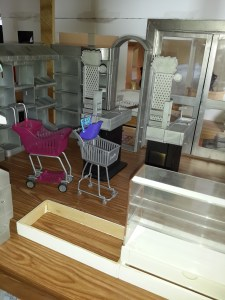 The white frame on the ground is to hoist the next Re-ment display cabinet to a height more accommodating for the dolls. Shopping carts will be repainted