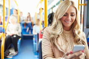 woman-bus-cell-phone