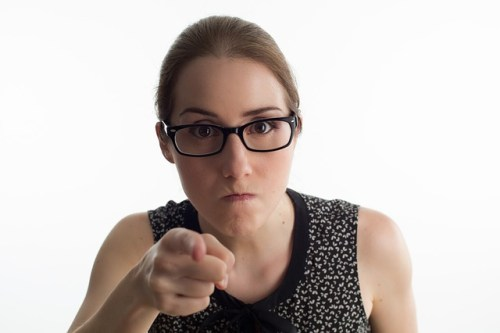 blame blaming woman pointing finger in anger