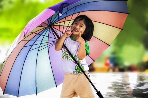 happy little girl under umbrella stay positive