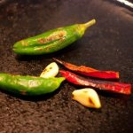 peppers and garlic in the skillet