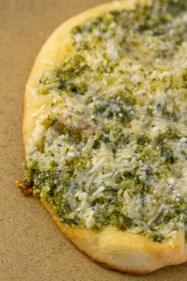 pizza made with basil pesto.