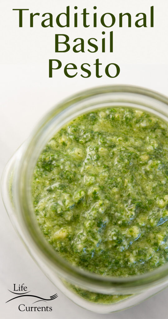looking down into a jar of pesto, title on image: Traditional Basil Pesto.