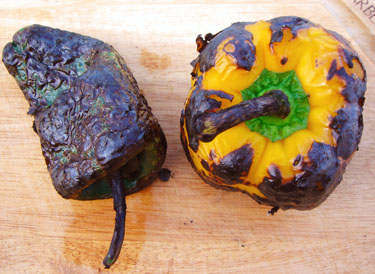 The chili peppers are blackened on all sides and are ready to steam in a bowl Cooking Basics – Roast a Chili Pepper