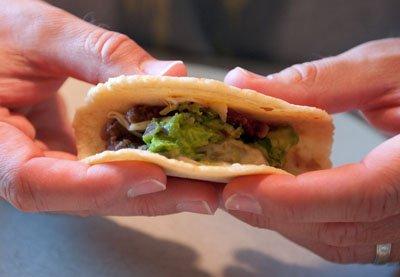 Homemade tortillas encase fillings like Seasoned Black Bean Mash, Verde Queso Fun-dito, and Homemade Guacamole.