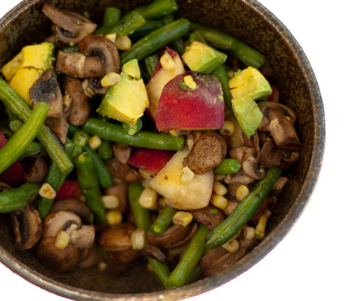 Summer Salad with fresh white peaches, roasted corn, green beans, avocado, and mushrooms. Summer in a bowl! #vegan #salad #summer