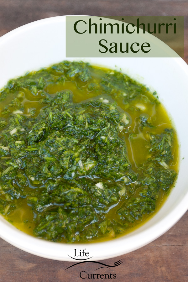 Chimichurri sauce, an Argentinean sauce or condiment based on olive oil, herbs, and garlic