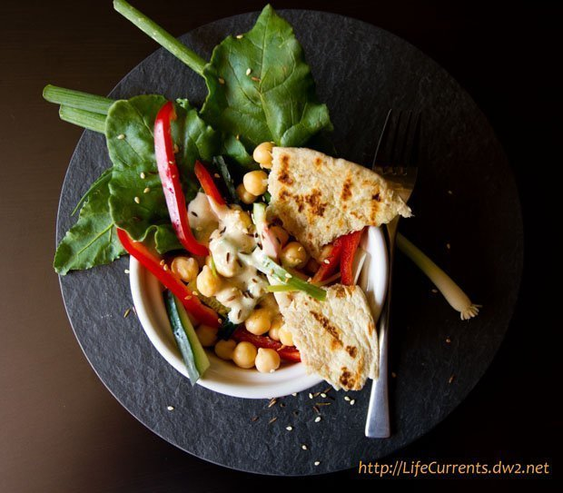 deconstructed hummus salad with tahini dressing and flatbread croutons