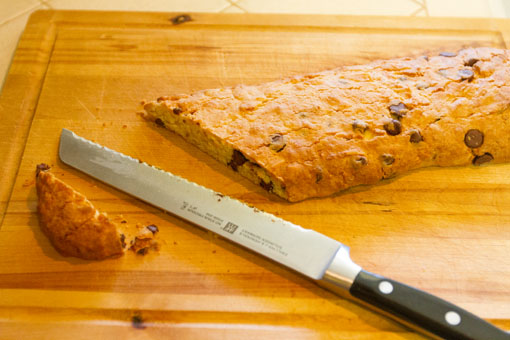Almond Biscotti starting to cut one of the logs on the diagonal