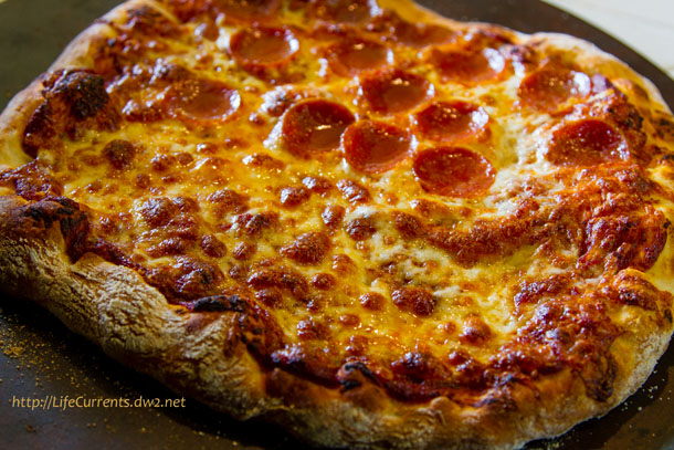 1/2 pepperoni for the husband, and 1/2 cheese for me: This Homemade Thin Crust Pizza from ATK is da bomb! And, when it's served with my pizza sauce, there's no need to go out to a pizza place. #budget #pizza #thinCrust https://lifecurrentsblog.com
