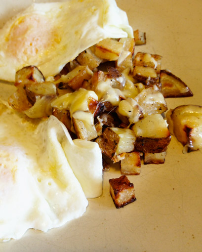 Roasted russet Potatoes with an egg